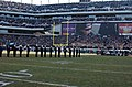 US Navy 050123-N-4729H-066 Marines, Sailors and Airmen assigned to Philadelphia, Pa., area bases, salute during the National Anthem prior to the start of the National Football League National Football Conference championship ga.jpg