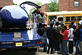US Navy 050615-N-6525H-101 Charlestown High School students exit the U.S. Navy Blue Angels F-A-18 Hornet simulator during Boston Navy Week, a week of Navy events and activities throughout the area.jpg