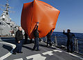 US Navy 060112-N-2385R-152 Sailors launch a killer tomato prior to executing a live fire exercise.jpg