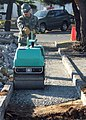 US Navy 060129-N-3590R-012 Construction Electrician 2nd Class Jorge Salazar assigned to Naval Mobile Construction Battalion Four (NMCB-4), Det Atsugi, compacts the soil.jpg