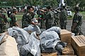 US Navy 060219-M-8084P-014 Members of the Philippine Army help U.S. Marines and sailors, Feb. 19, unload blankets from a CH-46E Sea Knight helicopter as part of the relief effort being conducted at the request of the Philippine.jpg
