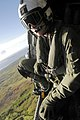 US Navy 060619-N-6074Y-095 Aviation Warfare Systems Operator 2nd Class Patrick Sullivan, assigned to the Golden Falcons of Helicopter Anti-Submarine Squadron Two (HS-2) scans the landscape.jpg