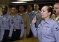US Navy 070129-N-5330L-015 Aviation Electronics Technician 3rd Class Courtney Busdeker and 15 other Sailors aboard the Nimitz-class aircraft carrier USS Dwight D. Eisenhower (CVN 69) repeat the Oath of Enlistment during a histo.jpg