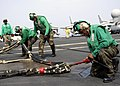 US Navy 070804-N-1598C-052 Sailors of V-2 division connect the barricade to its station during flight deck drills aboard the nuclear-powered aircraft carrier USS Enterprise (CVN 65).jpg