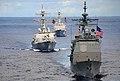 US Navy 070814-N-9760Z-081 USS Princeton (CG 59), USS John Paul Jones (DDG 53) and USS Pinckney (DDG 91) transit behind the nuclear-powered aircraft carrier USS Nimitz (CVN 68) during a joint photo exercise.jpg