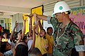 US Navy 071026-N-7367K-020 Senior Chief Builder E. Dan Walker, the senior enlisted leader of U.S. Naval Mobile Construction Battalion (NMCB) 1, Guam Det., reaches out to the students at Chief Brodie Memorial Elementary School.jpg
