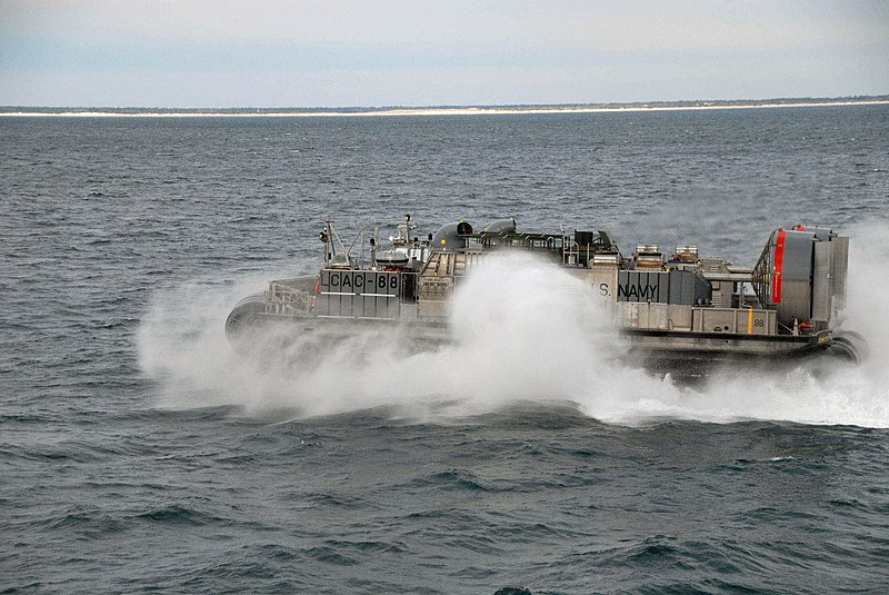 File:US Navy 071206-N-2979K-005 Sailors stationed aboard the dock landing ship USS Ashland (LSD 48), watch a Landing Craft Air Cushion (LCAC), piloted by Sailors attached to Assault Craft Unit (ACU) 4, operate in Onslow Bay.jpg