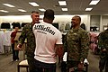 US Navy 080103-M-5276L-008 Col. Christopher E. O'Conner, CO of the Marine Corps Air Station (MCAS) Miramar, and Sgt. Major Doneil C. Yarn greet Quinton.jpg