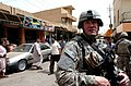 US Navy 080607-N-1765B-278 Lt. Cmdr. Doug Kunzman visits the marketplace in Ramadi to meet with business owners to discuss electricity availability.jpg