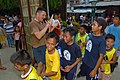US Navy 080614-N-7498L-201 U.S. Navy Lt. Cmdr. Mike Lukich, a member of the Civil Engineer Corps assigned to the 30th Naval Construction Regiment based at Port Hueneme, Calif., congratulates Filipino children as they finish a 3.jpg