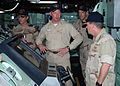 US Navy 081112-N-0803S-001 Cmdr. Kurt Kastner, center, commanding officer of the amphibious transport dock ship USS San Antonio (LPD 17) describes the capabilities of the ship to Vice Adm. Bill Gortney.jpg