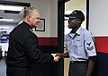 US Navy 090109-N-8273J-175 Chief of Naval Operations Adm. Gary Roughead congratulates Yeoman 2nd Class on his recent promotion through the command advancement program.jpg