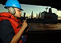 US Navy 090613-N-7282P-096 Seaman Richie Zapata, assigned to the deck department of the aircraft carrier USS George Washington (CVN 73) operates a sound powered phone to communicate with the navigation bridge.jpg