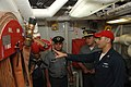 US Navy 090714-A-8397T-003 Damage Controlman 2nd Class Christopher Gipp, assigned to the amphibious dock landing ship USS Oak Hill (LSD 51), gives Sailors from the Brazilian Navy a tour of damage control spaces.jpg