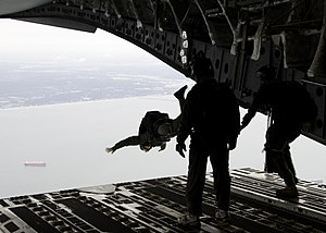US Navy 091014-N-8949D-003 A Soldier assigned to the 3rd Special Forces participating in the Wounded Warrior Program parachutes from a C-130 Hercules during a maritime craft aerial deployment system exercise.jpg