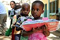 US Navy 091102-N-2420K-127 A child holds a packet of school supplies at the Tongoni Primary School in Tanga, Tanzania.jpg