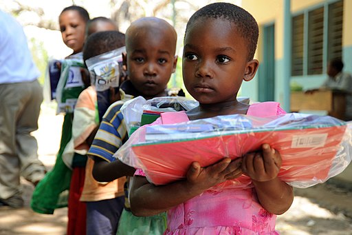 US Navy 091102-N-2420K-127 A child holds a packet of school supplies at the Tongoni Primary School in Tanga, Tanzania