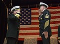 US Navy 100126-N-8053S-082 Master Chief Scott Weaver, right, command master chief, U.S.Naval Forces Central Command, salutes Vice Adm. Bill Gortney, commander, USNAVCENT at his retirement ceremony at Naval Support Activity Bahr.jpg