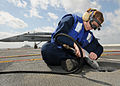 US Navy 100303-N-9793B-007 Aviation Boatswain's Mate (Handling) Airman Taylor L. Chandler performs restoration work on the ship's flight deck.jpg