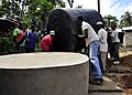US Navy 100913-N-7241L-007 Residents of Fundo Island, a small islet that is part of Pemba Island, carry a 5,000-liter water cistern to a concrete s.jpg