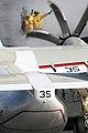 US Navy 100913-N-7605J-011 Aviation Boatswain's Mate (Handling) 3rd Class Alexis Fernandez, left, observes as Aviation Boatswain's Mate (Handling).jpg