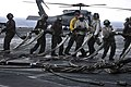 US Navy 101016-N-7103C-014 Sailors pull the barricade netting to a staging area on the flight deck during a barricade drill aboard the aircraft car.jpg