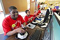 US Navy 110131-N-PK678-011 Students participating in the STARBASE-Atlantis science academy work on flight simulators.jpg
