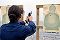 US Navy 110919-N-ZF681-107 Ensign Jennifer Rubin fires a 9mm handgun during small arms qualifications aboard the guided-missile destroyer USS Halse.jpg