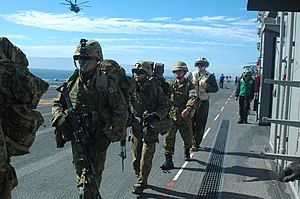 US Navy 120210-N-XH369-006 Members from the Japan Ground Self-Defense Force file along the flight line for their air assault aboard the amphibious.jpg