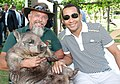 Ulrich Andriantiana, Minister of Foreign Affairs, Madagascar meets a wombat from Caversham Wildlife Park.jpg