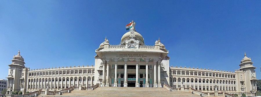 Photo of Bangalore parliament building with 18 archway columns and 10-column entrance under dome with 2 spire towers