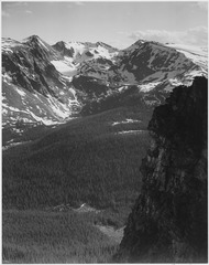 "View of snow-capped mountain timbered area below, ""In Rocky Mountain National Park,"" Colorado. (Vertical Orientation), 1 - NARA - 519959.tif"