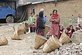 Villagers With doko to collect the filter unit (12173635356).jpg