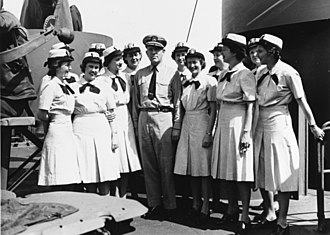 USS General Omar Bundy (AP-152) - Officers pose on the navigation bridge of USS General Omar Bundy. Captain Lawrence Wainwright, (Center) En route to Pearl Harbor, Hawaii.