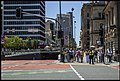 Waiting to cross road to city-1 (15170219403).jpg