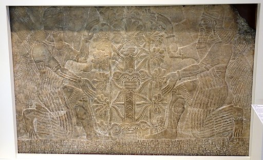 Wall relief with two winged spirits venerating a sacred tree and King Ashurnasirpal II inscription, Nimrud, Northern Mesopotamia, Neo-Assyrian dynasty, c. 884-859 BC, alabaster - Royal Ontario Museum - DSC04528