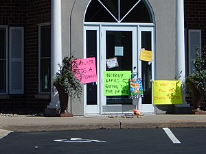 Killing of Cecil the lion - Activist placards at Palmer's dental practice in Bloomington, Minnesota.