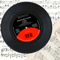 "WikiProject Songs 7"" record on sheet music.png"