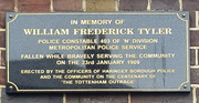 Plaque in memory of PC Tyler on the outside wall of Tottenham Police Station, London.