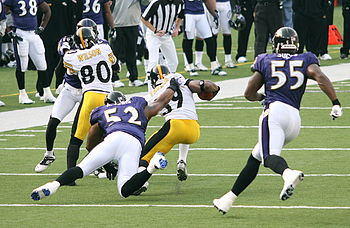 6720bda870f Ray Lewis (No. 52) and Terrell Suggs (No. 55) each won the award playing  for the Baltimore Ravens.