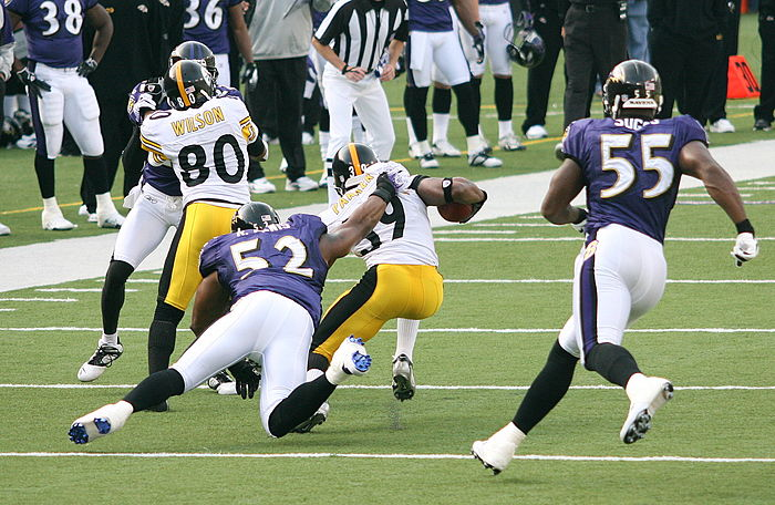 Ray Lewis (No. 52) and Terrell Suggs (No. 55) each won the award playing for the Baltimore Ravens. Willie Parker and Cedric Wilson.jpg
