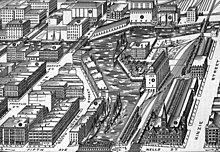 19th century black and white lithograph print showing a river lined with industrial buildings and railroads