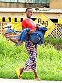 Woman carrying boy, Burkina Faso, 2009.jpg