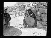 Woman weaving a straw mat. Semi Bedouin type in M'Keis, ancient Gadara LOC matpc.15656.jpg