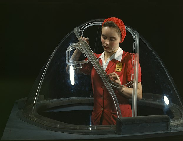Woman worker dressed in red in the Douglas Aircraft Company plant 1942