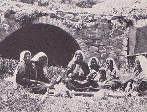 Artas, Bethlehem - Women of Artas demonstrating weaving on a ground loom for Grace Crowfoot, circa 1944.