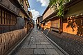 Wooden and bamboo facades of dwellings with sudare in a cobbled street of Gion, perspective effect with vanishing point, Kyoto, Japan.jpg