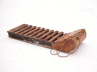 Sledding - Old-fashioned wooden sled (or Toboggan without runners)