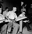 Workmen of the Polymer Corporation Limited plant enjoy a game of bowling in the plant bowling alleys, Sarnia, Ontario (34968527265).jpg