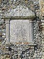 -2018-12-10 Weather worn plaque, Saint Margaret of Antioch parish church, Suffield, Norfolk.JPG